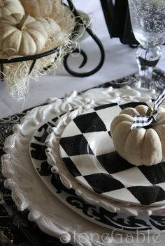 Black and White And BOO Tablescape. Absolutely love the mixed patterns and design of the plates. The checkered one is so visually interesting!