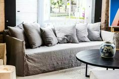 Loose linen slipcover sofa. Adds depth and so comfy. Plus so easy to maintain and you don't even need to iron the covers