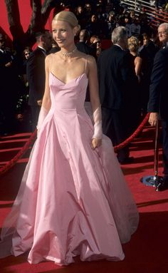 Gwyneth Paltrow in Ralph Lauren, 1999I, like everyone else right now, am having a moment with pink, so I live for this Gwyneth Paltrow pink dress by Ralph Lauren from 1999. Its simple form paired with that slicked-back hair is everything we loved about '90s Gwyneth!—Brooke Persich, Vogue.com Editorial Producer