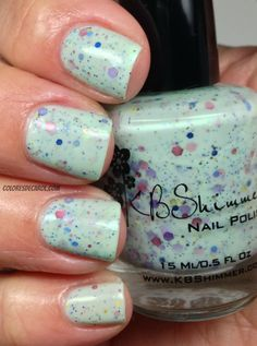 Spring Training, is a soft green crelly (creme/jelly)  full of pink, purple, blue and green floral toned glitters, scented with a floral freesia note.
