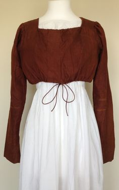 c1810 Brown silk bodice. Ties fasten two front flaps (waist tie not original). Linen/ polished cotton lining.