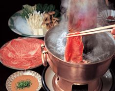 Shabu Shabu -- Beef cut into paper-thin slices, dropped piece by piece into a broth in a common pot, then dipped in a sauce—this is shabu-shabu, one of Japan's best known meat and vegetable dishes, along with sukiyaki.
