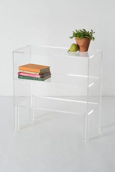 Illusion Bookshelf #anthropologie  i luv acrylic furniture yet i have none in my home&@1400bucks it might stay that way
