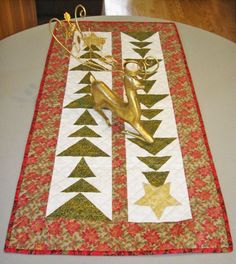 "Tall Trees Christmas Table Runner By Gormick, Betty  - 19in x 41in. Project Time: 2-6 Hour. Fabric Type: Yardage Friendly. Project Type: Home. CLP patterns are printed on 8-1/2"" x 11"", anti-copy card stock. Because they are customized with your shop's Bill-to account name, phone number and web site, they are not returnable."