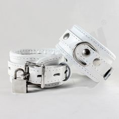 """These high quality hand crafted restraints cuffs ensure that you or your partner are under control! These premium genuine leather restraints are 2 inches wide and reinforced with three layers of leather.    Features:    1) Ideal to control and restraint!  2) All studs are covered by leather to protect your skin/body.  3) Premium D rings and fittings.  4) Use a padlock for extra security. (FREE TWO PADLOCKS)  5) Measures approx. 12.5' (32 cm"""") total length and 2' (5 cm"""") in width.  6) Fits…"""
