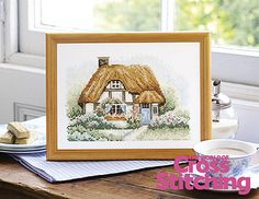 Country cottage cross stitch design by The World of Cross Stitching, issue 194