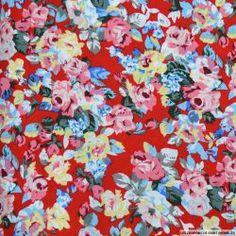 Coton imprimé fleurs multicolores sur fond rouge