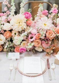Pink, peach, and cream wedding tablescape from Minted.