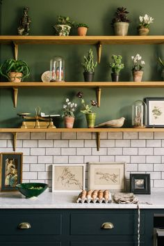 dark green kitchen This DeVol kitchen is gorgeous - I love the earthy green paint, rustic wooden shelves and dark grey cabinets, which are brought together by the light marble workto Kitchen Shelves, Kitchen Tiles, Kitchen Decor, Kitchen Cabinets, Kitchen Wall Lighting, Kitchens With Open Shelving, Green Kitchen Cupboards, White Tile Kitchen, White Kitchen Worktop