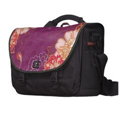 """Elegant vintage purple pink and red floral messenger bag.  Like many of my designs this one has several layers.  Add your photo and/or text between any layers.  Contact me at ElizaBGraphics@aol.com if you need any help.  •Dimensions 11"""" H x 15.75"""" W x 4.75"""" D. •Water resistant, extra durable construction. •Holds up to 15"""" laptop (sleeve included). •2 large front pockets and rear organizational pocket. •Magnetic silencers, Velcro, and clip flap fasteners."""