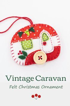 A vintage caravan trailer hanging ornament, handmade from felt and decorated with fabric scraps. With tiny felt bunting and buttons for the wheel and door knob. A perfect Christmas ornament or gift for a trailer owner or anyone who loves camping.With blanket stitched edges and a cotton loop for hanging, the ornament is flat in shape, with a plain felt back.Size approx 3 x 2.5 inches / 7.5 x 6.5 cm. #feltchristmasornaments #feltornaments #vintagecamper #vintagetrailer #vintagecaravan Glass Christmas Decorations, Beaded Christmas Ornaments, Hanging Ornaments, Felt Ornaments, Glass Ornaments, Scandi Christmas, Christmas Crafts, Homemade Christmas, Christmas Christmas