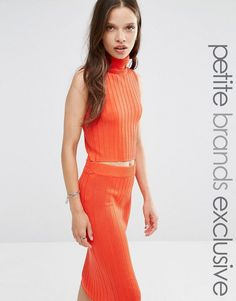 Buy it now. Noisy May Petite High Neck Ribbed Knitted Crop Top - Red. Petite top by Noisy May Petite, Chunky ribbed knit, High neckline, Sleeveless design, Cropped cut, Slim fit - cut close to the body, Machine wash, 80% Acrylic, 20% Nylon, Our model wears a UK S/EU S/US XS, Exclusive to ASOS. ABOUT NOISY MAY PETITE The younger and louder sibling of Danish brand Vero Moda, Noisy May is your go-to label for fashion-forward denim. Their petite collection scales down their range of dresses…