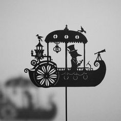 'trFor the rowers keep on rowing,  And they're certainly not showing  Any signs that they are slowing...   Roald Dahl  A Dream Steamboat / Laser-cut Shadow Puppet. $15.50, via Etsy. http://www.pinterest.com/memepistache/el-t%C3%ADtere-un-objeto-bello/