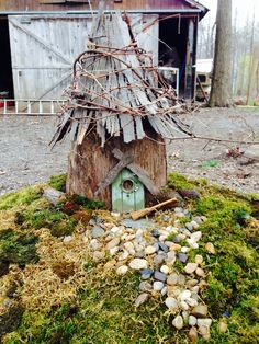 Fairy House I made from a stump, bark from a Cherry tree and grape vines. I used moss from around my yard for the lawn and dollar store stones for the walkway.