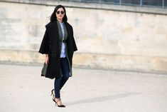 84 Outfit Ideas For Style Extroverts #refinery29  http://www.refinery29.com/2015/03/83675/paris-fashion-week-2015-street-style#slide-52  Layer a scarf underneath a shawl coat and keep it in place with a belt, like Nicole Warne does.Elie Saab coat, I Love Mr. Mittens scarf, J. Brand jeans, Aquazzura heels.