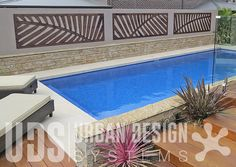This trio of custom Palm fronds was a finishing touch to this recent pool renovation project. Whilst the Palm fronds compliment the overall tropical-style garden design, the colour and texture of the natural timber grain sit comfortably alongside the palette of materials incorporated throughout the space. The Exterior High Impact Board from Weathertex is a really diverse and durable product and a perfect material option for anyone wanting an authentic woodgrain effect.