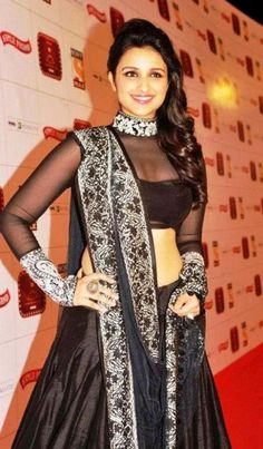 Elegant and yet sexy saree blouse designs with photographs to help you choose the perfect saree blouse design for weddings and parties. Look stunning in ethnic saree and be the center of attention. Blouse Designs High Neck, Netted Blouse Designs, Saree Blouse Designs, Couture Mode, Couture Fashion, Sari Bluse, Lehenga Blouse, Lehenga Choli, All Black Dresses