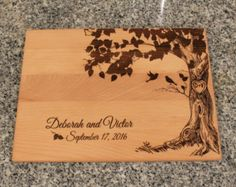 Our personalized cutting board makes a special and unique gift for a wedding, anniversary, family gift or any special occasion. The cutting board may be personalized with a family name, the names and date of a couple celebrating their wedding or anniversary. The cutting board is approximately 12 x 9 inches and comes in a variety of hardwoods which make an excellent choice for a cutting/chopping board. The front is engraved for displaying on a counter while the back is left plain for chop...