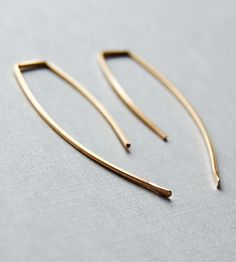 "Hammered Arc Earrings | If ""hand-forged"" conjures up images of clunky iron and antiqua... 