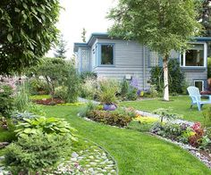 Break up Open Spaces     Give your garden an exciting, contemporary feel by breaking up the lawn into small sections. Here, the Amstrups gave their lawn a flowing design, punctuated by colorful flowerbeds. It adds more interest than colorful borders surrounding a big patch of grass Low Maintenance Landscaping, Landscape Curbing, Curb Appeal, Bellisima, Outdoor Structures, Patio, Summer, Outdoor Decor, Plants