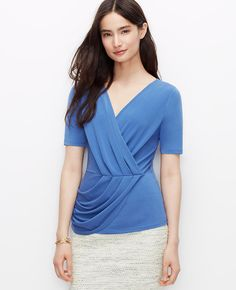 One of our all time greatest fits, this stunning crepe separate flaunts a figure-defining pleated waist for a look you'll want in every color. V-neck with crossover front. Short sleeves.