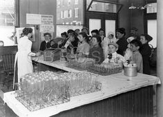 People at Milk Counter, circa 1915. Starr Centre Association of Philadelphia. Image courtesy of the Barbara Bates Center for the Study of the History of #Nursing.