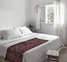 white bedding + blanket