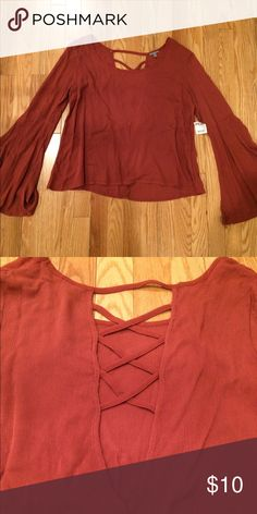 NWT Charlotte Russe medium rust top Bell sleeve Size medium rust colored Bell sleeve top. Never been worn. NWT. No stains or imperfections. Smoke free home. Offers and trades are welcome. Listed on Ⓜ️ Charlotte Russe Tops
