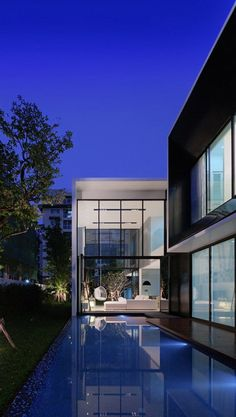 L-Shaped Modern Family Home in Bangkok, Thailand: YAK01 House to find your Hawaii dream home call 808-389-0489