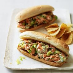 In this clever take on the summertime classic, salmon replaces lobster and yogurt stands in for mayonnaise. Topping rolls with potato chips adds crunch and fun. Mega Sandwich, Salmon Sandwich, Salmon Salad, Fish Recipes, Seafood Recipes, Great Recipes, Cooking Recipes, Favorite Recipes, Recipe Ideas