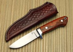 """Burt Foster Handmade Knives Loveless Hunter This knife is my version of the drop point hunter Bob Loveless. Blade is forged, full-tang 52100 which has a hand-rubbed finish on the blade flats and is mirror polished around the tang. Guard is stainless steel with desert ironwood handles with stainless bolts and lanyard tube.. Blade length is 4"""" with an overall length of 8.75 inches."""