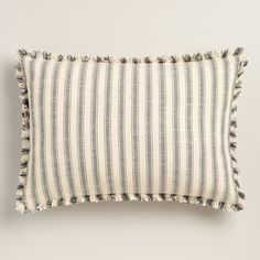 Featuring a blue and white striped pattern with frayed fringe edges, our exclusive lumbar pillow enhances your relaxation space with a soft feel and a modern design.