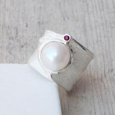 Excited to share the latest addition to my #etsy shop: Big Pearl Ring, Sterling Silver Wide Band with White Real Pearl and Natural Red Ruby, Pearl Wedding, June Birthstone Ring, Pearl Jewelry #women #pearlring #silverpearlring #widebandring #pearlandruby #bigring #sculpturedring #pearlwedding #junebirthstonering