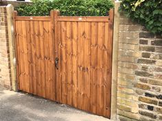 Flat top driveway gates with fleur de lys header. Add security and privacy to your home with a gate from our London design range. Driveway Entrance, Entrance Gates, Driveway Landscaping, Western Red Cedar, Header, Tall Cabinet Storage, Garage Doors, Gate Ideas, Backyard