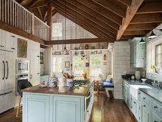 cabin kitchen | Ennis Nehez - Love the detail here. Bright and open but rustic, too. Would probably paint the rafters.
