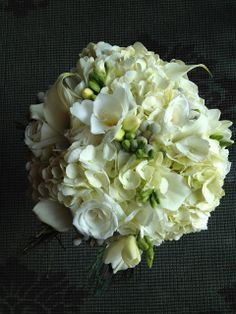 Bride & Blooms -  White roses, white calla lilies, hydrangeas and...