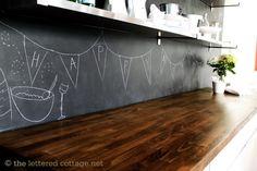 love butcherblock countertop, chalkboard paint & stainless shelves