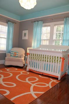 gray walls with pops of orange and turquoise - guest bedroom
