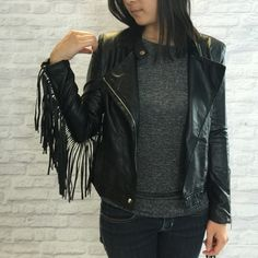 Fringe Vegan Leather Jacket See how much fun I'm having in this jacket.  Nail the edgy boho look with this stunning black faux leather jacket w/ fringe from Style Mafia - one of my favorite emerging designers based out of Miami.  So on trend - style with a white tee, skinny boyfriend jeans, and heels.  Fit: I am always a size 2 and this fits me very comfortably (not too snug can layer thin sweater underneath).  Brand new with tags!  MSRP $110. Style Mafia Jackets & Coats