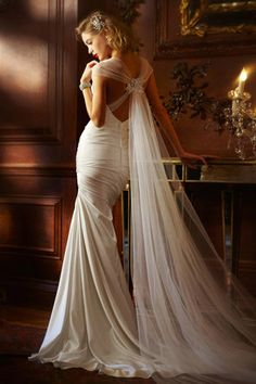 David's Bridal  --- This is perfect!! The design I love, AND it solves my veil problem with having no hair and not wanting a hat! :D