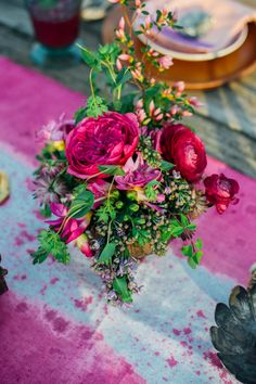 Berry colored floral centerpiece | Paula Bartosiewicz Photography | see more on: http://burnettsboards.com/2014/05/bohemian-gemstone-shoot-diy-elements/