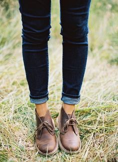 a woman in clarks and blue jeans.