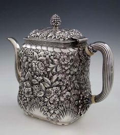 Tiffany & Co sterling silver teapot in a floral repoussé pattern, with a shell motif around the base. New York, c1881 (Britannia Silver)