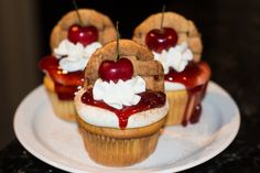 These vanilla buttermilk cupcakes have a miniature bourbon cherry pie baked inside the middle! They're also frosted with a bourbon buttercream and topped with cherry pie filling, whipped cream, lattice pie cookies, and giant juicy cherries!