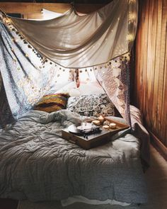 Diagonally oriented bed with pom pom trim tapestry and backlighting.