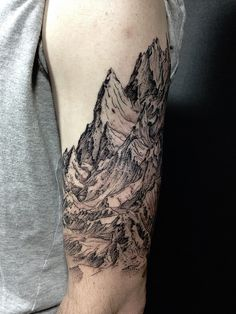 Mountain upper arm tattoo black line