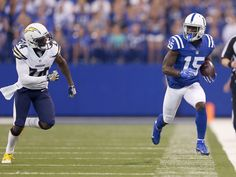 Indianapolis Colts wide receiver Phillip Dorsett (15) runs the ball out-of-bounds as he's pursued by San Diego Chargers cornerback Brandon Flowers (24) during the first half of an NFL football game Sunday, Sept. 25, 2016, at Lucas Oil Stadium.  Mykal_McEldowney/Indy_Star