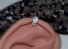 I want to get this piercing. Very cute earring for it @ http://www.etsy.com/listing/125742965/flower-ear-cuff-cartilage-or-lobe