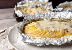 Potatoes Au Gratin Foil Packets: A classic French side dish made on the grill so you can keep your oven off! Great for any grilled summer meal.