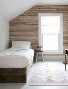 attic bedroom accent wall - bedroom with horizontal wood plank wall - redcottageinc via atticmag